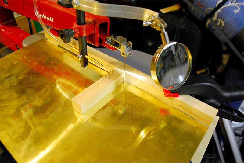 Cutting brass with the fret saw.