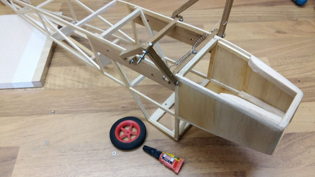 Assembling the wheel axle.