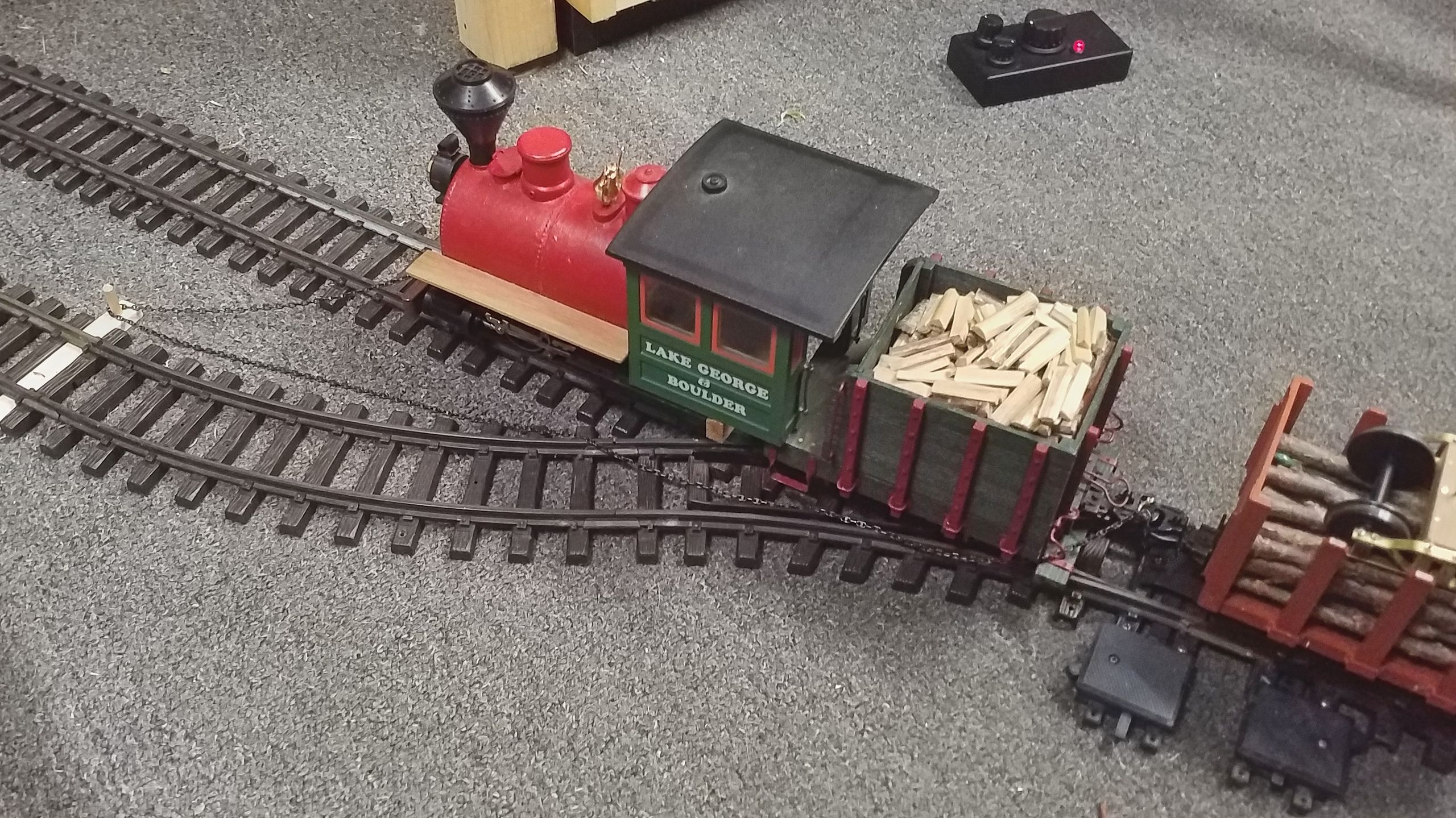 The loco's chain is laid around the first bollard and fastened to the waggon.