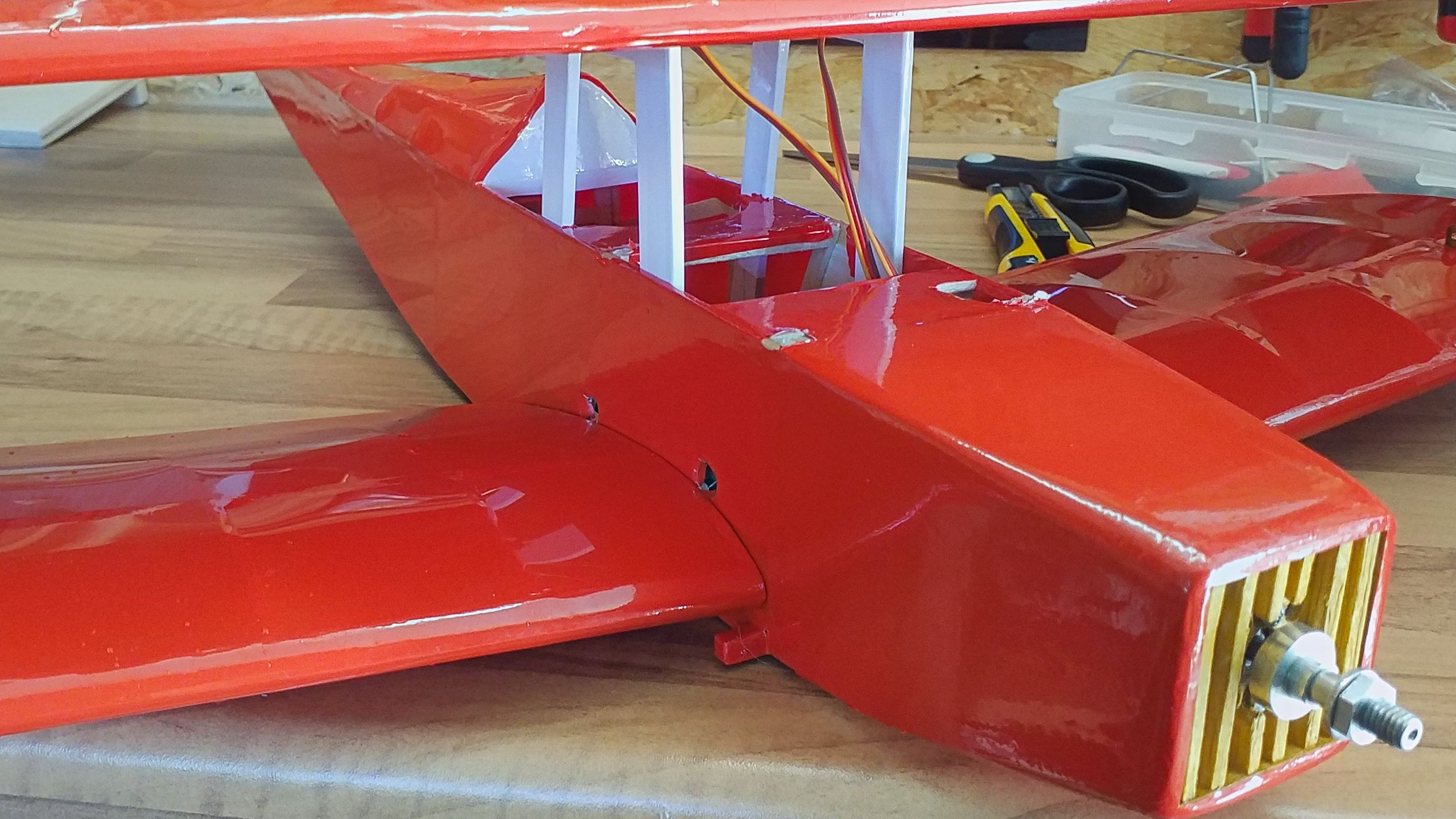 The new wing mounting made from plywood is seated farther to the rear.