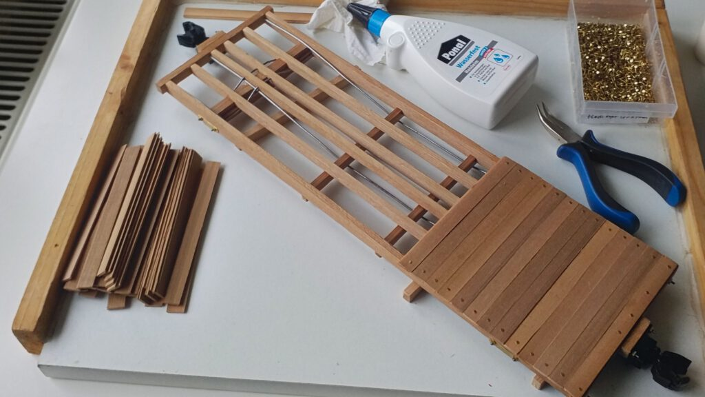 The floor boards are white-glued and nailed to the frame.