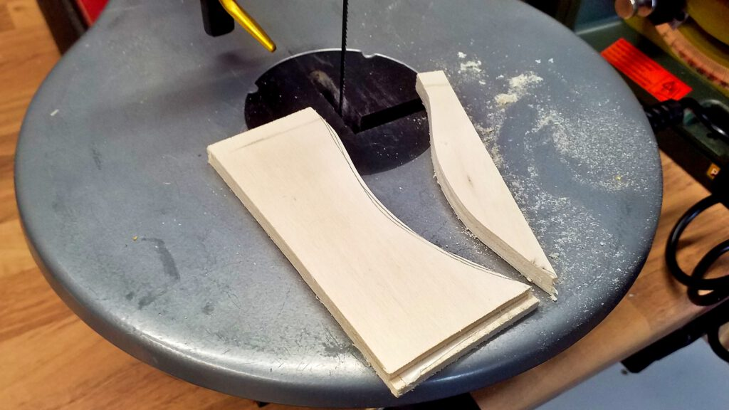 The curved upper contours are cut with the fret saw.